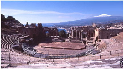Greco-Roman amphitheatre with Etna and the sea in  the background.